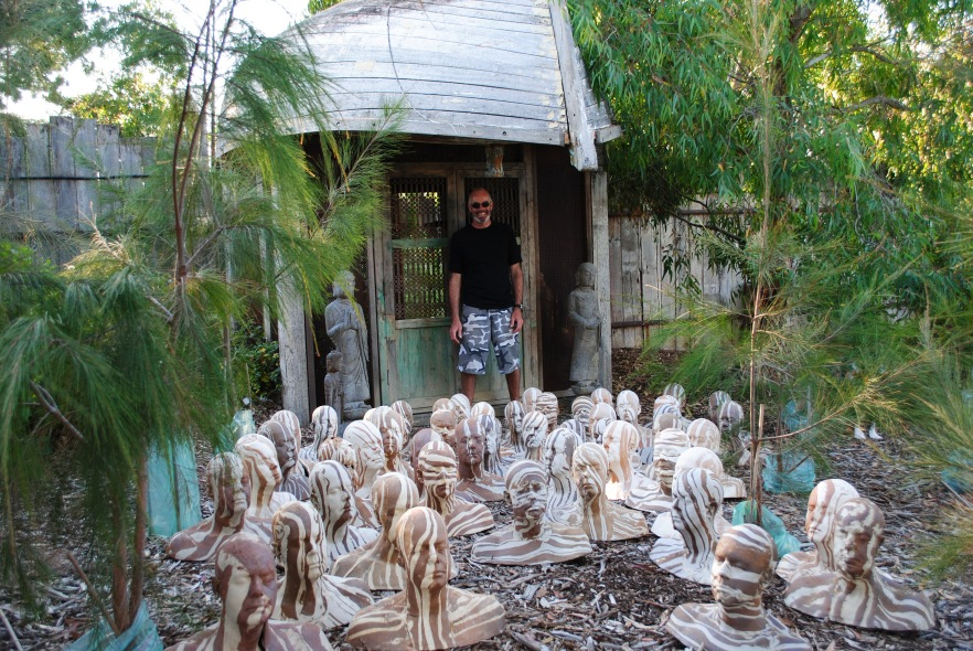 Michael with his 50 head copy sculptures of fired raku collected in front of Secret Garden, November 2012